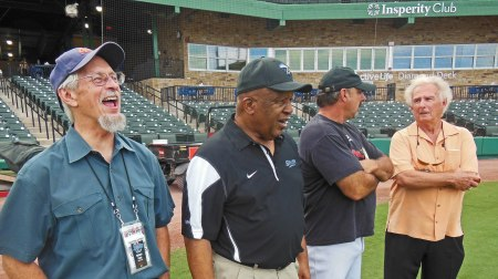 Watching Charlie Pride pound the ball are: Michael Point, a writer for the Corpus Christi Hooks, Deacon Jones, Skeeters Manager Gary Gaetti, and Skeeters Special Advisor Tal Smith. The hits just rang and rang and rang.