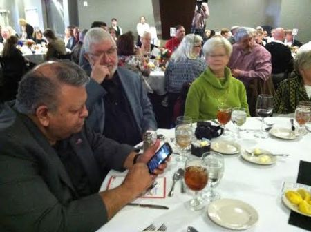 Sam Quintero, Bill McCurdy, and Marsha Franty share a quiet moment at the SABR table.