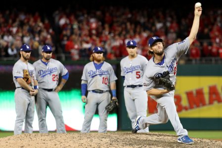 High Drama: WIth the tying and winning runner on base for the Bationals, Clayton Kershaw prepares to come in and close victory for the Dodgers in Game 5 of their NLDS.