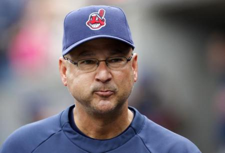 In this photo of Cleveland Indians Manager Terry Francona, can you spot the two things it contains that are potentially bad for baseball and those who play the game?