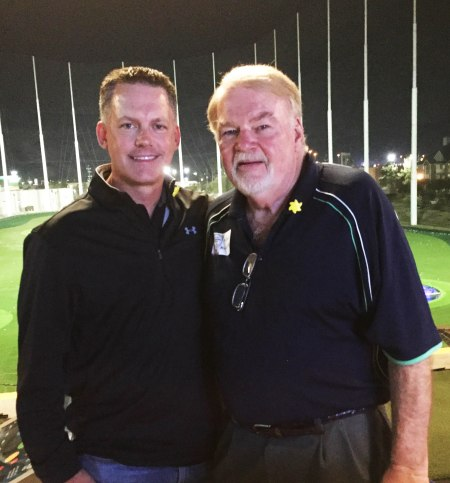 Houston Astros Manager A.J. Hinch, Mike McCroskey, and the driving range beyond them at Top Golf. Photo by Mike McCroskey