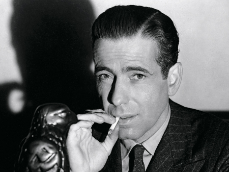 """Stuff it Cairo, and just get you mind ready to have the first heroic day of your weasel life. In the meanwhile, keep your trap shut. You don't want me to attach this ""stuff that drems are mde of"" trophy to a part of your body that will make it hard for you to go long for anything!."" - Sam Spade in a calm and delivered response to Cairo's comments."